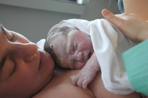 woman-with-newborn-baby-on-her-chest