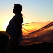 silhouette-of-pregnant-woman-with-sun-behind-her