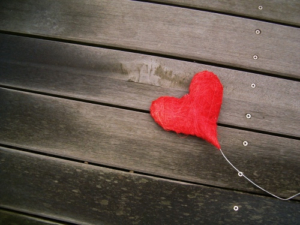 red-heart-on-wooden-floor