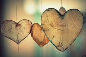 three-wooden-hearts-hanging-on wire