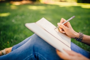 woman-writing-in-a-journal